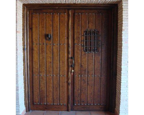 Puertas de madera artesanales ruarte for Remate de puertas de madera